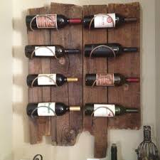 We decided to make our own wine rack from local old barn wood. This is