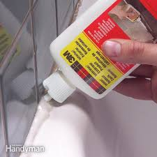 apply a caulk remover to simplify the job of removing old caulk from joints it loosens the caulk so you can easily dig it out