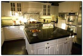 dark granite countertops with light backsplash white kitchen cabinets with black granite dark granite countertops with