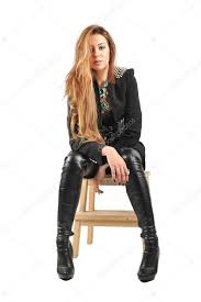 women wearing black jacket and black socks and long leather boots with long brown hairs in