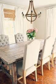 wicker emporium jasper dining chairs paired with a rustic farmhouse table nest of bliss chic dining room table