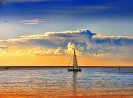 sunriswes rivers paradise sea beautiful surf yellow boat nice orange sky sailing clouds island fishman white