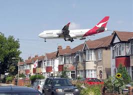 noise pollution a qantas airways boeing 747 400 passes close to houses shortly before landing at london heathrow airport noise pollution is the disturbing