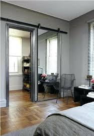 mirrored barn closet doors a sliding door mirror love this and it almost makes the room mirrored barn closet doors