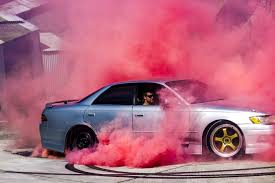 cousins partner performing a burnout to reveal first baby gender