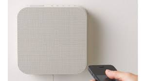 it borrows its design from the japanese company s popular wall hanging cd player but muji s new mountable bluetooth speaker is far more useful in this day