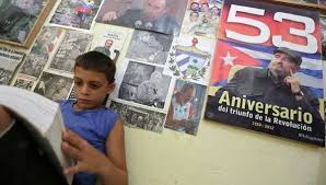 top writers in the americas announced at casa de las americas  marlon mendez an admirer of fidel castro reads a book in his bedroom in