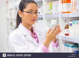 drugstore shelves shelf stock photos drugstore shelves shelf pharmacist reading medication pot from pharmacy shelf stock image