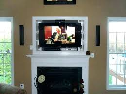 hanging tv over fireplace ideal mounting above install flat screen on brick hanging tv over fireplace