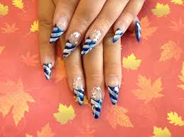 Stiletto Nails With Blue and White Nail Art - Nail Designs For You