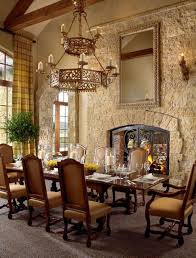 world dining room chairs tuscan style tuscan style dining room with stacked stone fireplace and sconces