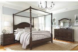 Lavidor King Canopy Bed | Ashley Furniture HomeStore