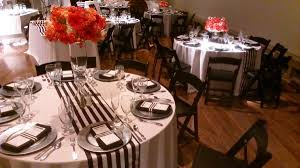 black white striped runners on round tables