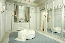 Bedroom with walk in closet Custom White Walkin Closet Design With Large Wall Mirrors And Ottoman Lushome 33 Walk In Closet Design Ideas To Find Solace In Master Bedroom