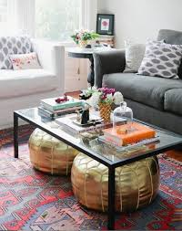 a black frame glass coffee table will fit a modern space and you can your