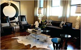 small white and black cowhide rug living room decoration idea square glass on top with chromed