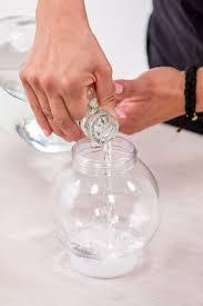adding water to diy snow globe craft