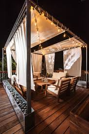 rooftop lighting. to turn an upstairs deck into a gorgeous retreat add some seating, string lights and rooftop lighting