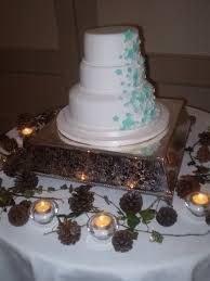 Simple 3 Tier Wedding Cake With Handmade White And Blue Flowers