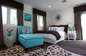 ... Stylish bedroom in white and chocolate brown with turquoise accent seat