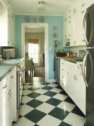 vintage style kitchen design idea with light blue painted wall feat white divine kitchen cabinet and diagonal black and white tiles flooring also round