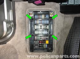porsche 911 carrera boxster carpet replacement 996 1998 2005 remove the four phillips head screws on the fusebox cover panel green arrows