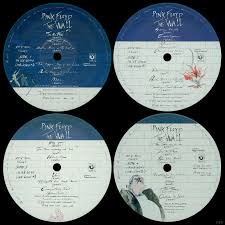 front cover white brick wall inside cover the credits on the inside cover do not list the members of pink floyd it only says wordusic roger
