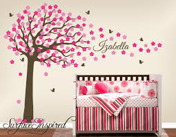 modern bedroom area with brown tree pink fl wall decal