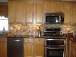 furniture brown wooden kitchen cabinet and beige mozaic tile backsplash connected by stainless steel stove