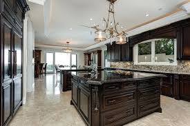 dark cabinets light granite luxury traditional kitchen with dark raised panel cabinets dark marble counter island and light images of dark cabinets with