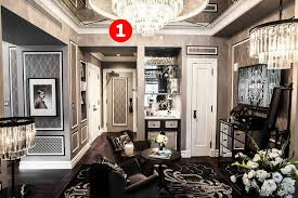 hanging above a sitting area is an 31 5 inch wide iron and glass chandelier from restoration hardware the 1920s odeon glass fringe chandelier