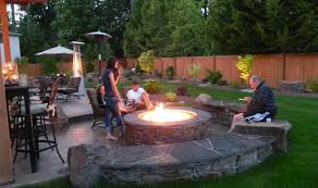 a fire pit installed on your deck patio or elsewhere in your backyard makes it possible for you to enjoy a beautiful summer evening