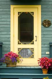 yellow paint screen door with transpa glass panel beautiful decorative plants wood planks wall system in decorative screen door wood