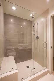 this modern bathroom has a large glass enclosed shower in tile the shower stall