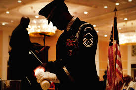 u s department of defense photo essay  air force master sgt toby mitchell lights a candle for the opening ceremony of the