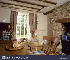 Image Chairs Country Cottage Dining Area With Wood Beamed Ceiling And Dining Table And Chairs In Front Of Stone Inglenook Fireplace Alamy Country Cottage Dining Area With Wood Beamed Ceiling And Dining