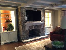 60 inch tv mounted above fireplace