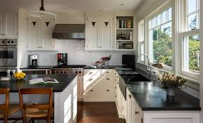 portland maine black soapstone countertops with granite undermount kitchen sinks beach style and bar seating stainless