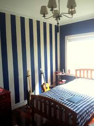 Striped Bedroom Paint Stripes In Navy On One Wall Behind Headboard Charmaines Room