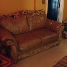 leather very soft and comfortable couch and loveseat real leather wood engraved trim
