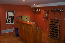 Splendid Orange Wall Painted And Wooden Counter Bar As Well As Floating  Whiskey Racks In Small Space Man Room Ideas