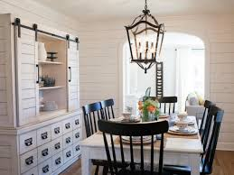 white dining room with shiplap walls large buffet and hutch and country lantern chandelier