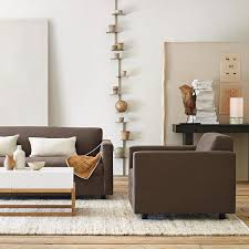 the above image shows furniture front legs on the rug and back legs off the rug this allows the feeling of a larger area rug for less cost