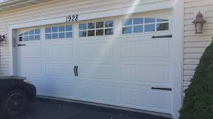 clopay gallery collection long panel with polyurethane insulation carriage style garage door