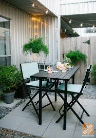 urban backyard decorating ideas string lights outdoor dining set and lots of greenery terrific small balcony furniture ideas fashionable product
