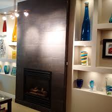 feature fireplace wall with dark tile and niches
