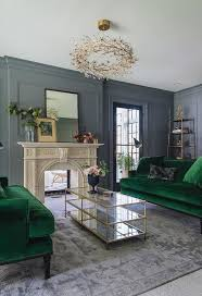 Gray Living Room Design Magnificent Elegant Gray Living Room Is Lit By A Gold Branches Chandelier Hung
