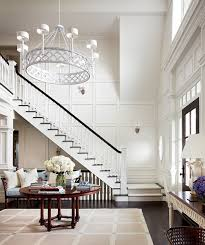amazing two story foyer with round foyer table sisal rug bench metal ornate