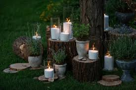 tall vase lighting garden. Tall Vases With White Candles Stand On The Blocks In Garden Free Photo Vase Lighting R