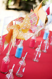 choose some s paper that works for you theme and create these easy pinwheels dress up the tables gift area or the cake s spot in the corner with these